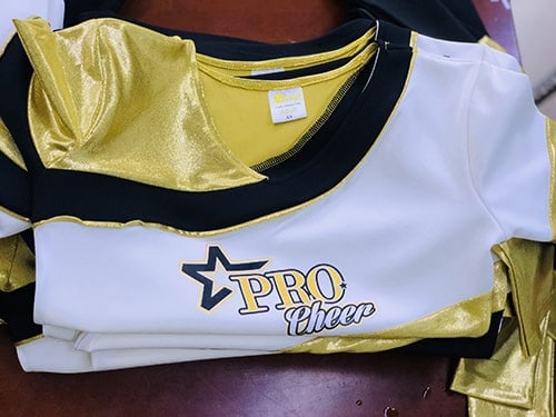 3 Producing cheerleading uniforms for customers in the USA