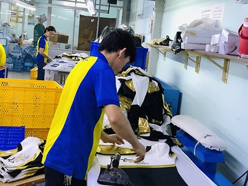 7 Producing cheerleading uniforms for customers in the USA