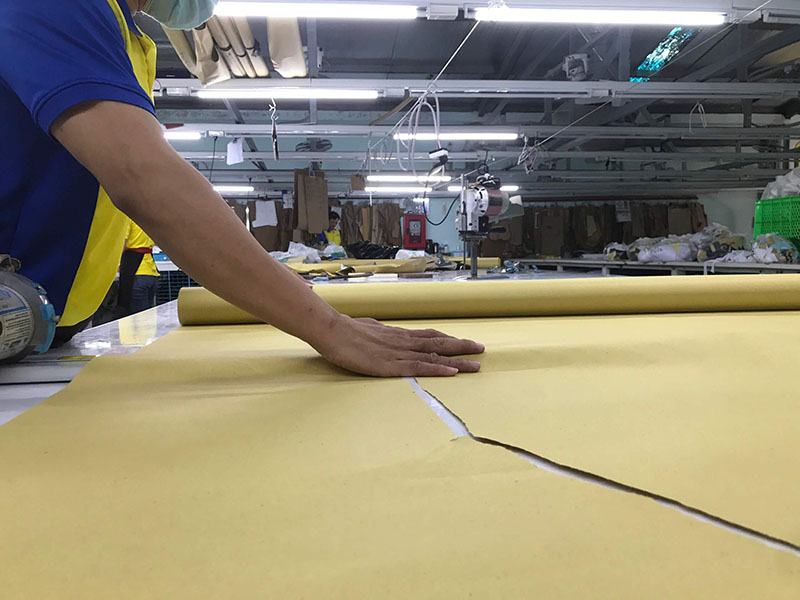 Each part of a shirt is being cut with great care because a single mistake makes the entire batch unusable.